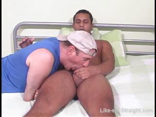 Hot Latino gay gets his cock sucked by a gay bear on the abut on