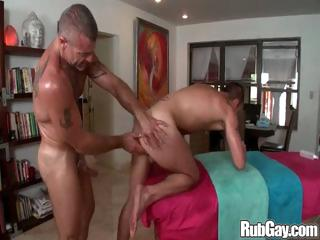 Simmering gay masseur hammers his massage client in his tight man ass