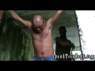 Hairy guy gets a flogging naked