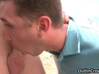 Blonde hunk gets penis sucked outdoor