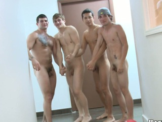 Nice basketball team is totally naked and absolutely horny, enjoy!